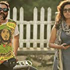 Parvathy Thiruvothu and Soubin Shahir in Charlie (2015)