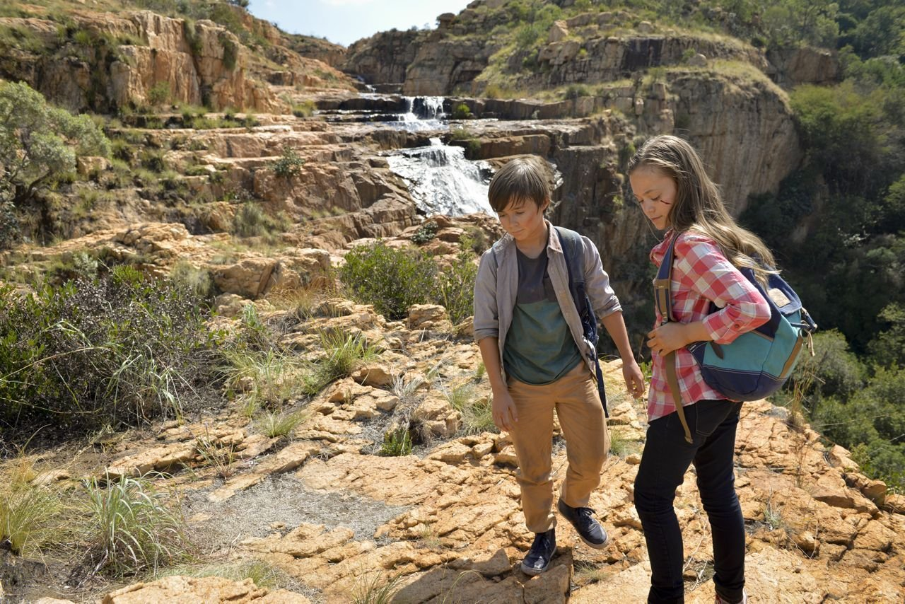 John Paul Ruttan and Ella Ballentine view the spectacular African falls in Against The Wild: Survive The Serengeti. May 2015, South Africa.