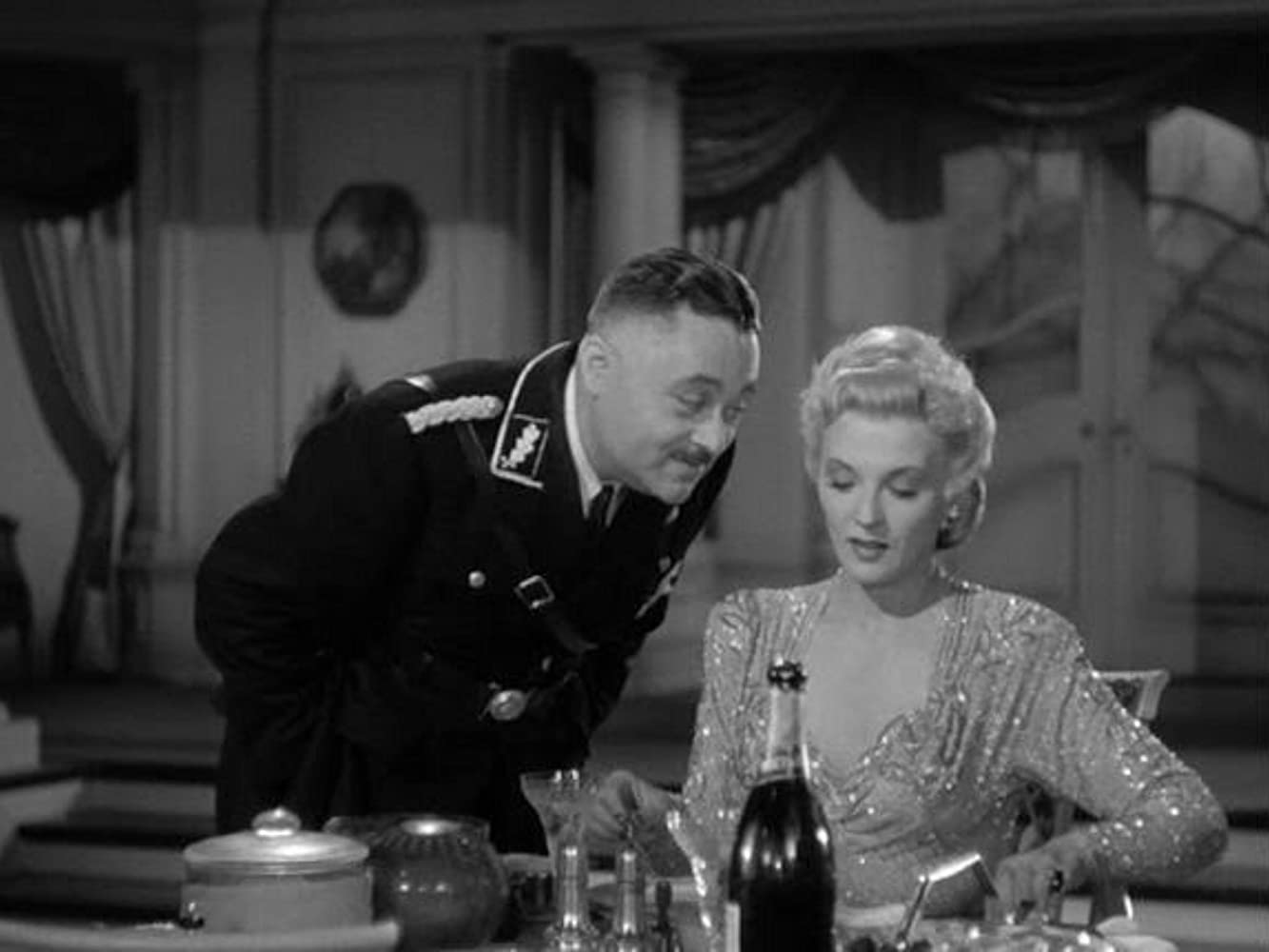 J. Edward Bromberg and Ilona Massey in Invisible Agent (1942)