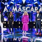 Jorge Corrula, César Mourão, Sónia Tavares, and Carolina Loureiro in A Máscara (2020)