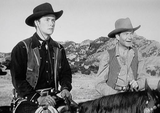 Earle Hodgins and Tim Holt in Riding the Wind (1942)