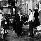 Peter Finch, Julia Arnall, Ian Carmichael, Philip Gilbert, and Kay Kendall in Simon and Laura (1955)