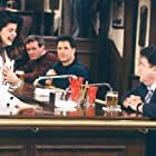 Kirstie Alley and George Wendt in Cheers (1982)