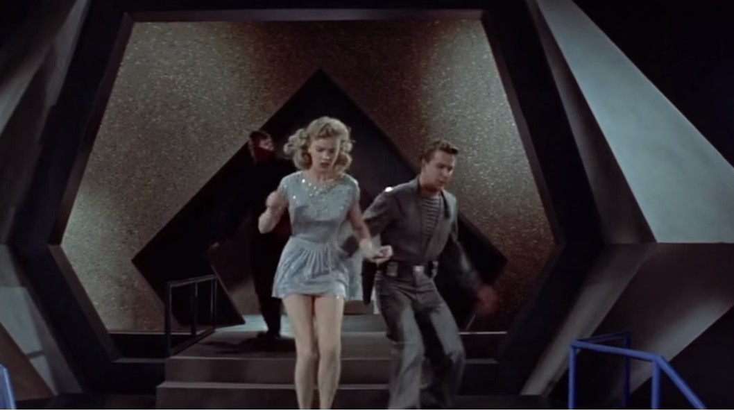 Leslie Nielsen and Anne Francis in Forbidden Planet (1956)