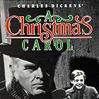 Terry Kilburn, Gene Lockhart, Kathleen Lockhart, and Reginald Owen in A Christmas Carol (1938)
