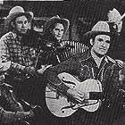 Gene Autry, Pat Brady, Hugh Farr, Bob Nolan, and Lloyd Perryman in Call of the Canyon (1942)