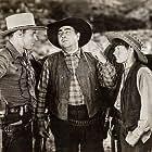 Richard Arlen, Junior Durkin, and Eugene Pallette in The Santa Fe Trail (1930)