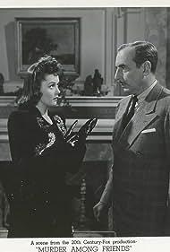 Douglass Dumbrille and Marjorie Weaver in Murder Among Friends (1941)