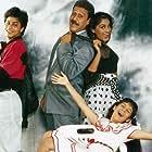 Jackie Shroff, Anu Agrawal, Shah Rukh Khan, and Pooja Ruparel in King Uncle (1993)