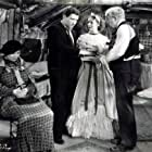 Spencer Tracy, Walter Connolly, Marjorie Rambeau, and Loretta Young in Man's Castle (1933)