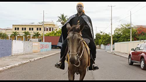 An impoverished preacher who brings hope to the Miami projects is offered cash to save his family from eviction. He has no idea his sponsor works for the FBI who plan to turn him into a criminal by fueling his madcap revolutionary dreams. Directed by Chris Morris ('Four Lions').
