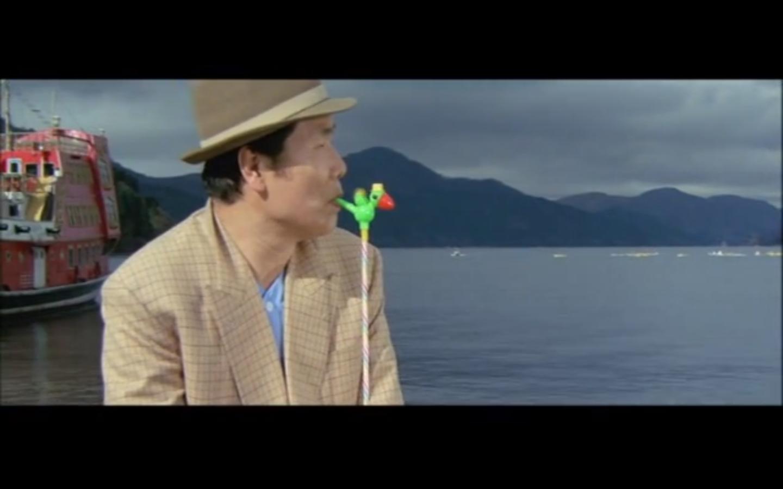 Kiyoshi Atsumi in Otoko wa tsurai yo: Shiawase no aoi tori (1986)