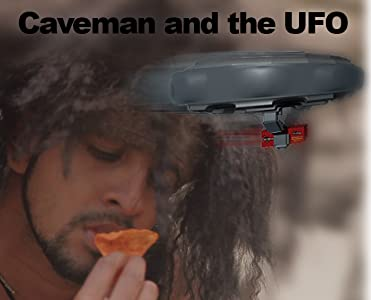 Watching english movies Caveman and the UFO by none [720x594]