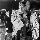 Edward Burns, Helen Ferguson, Jack Mulhall, and Eddie Phillips in Wild West (1925)