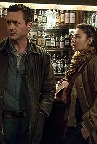 Jason O'Mara and Alexa Davalos in The Man in the High Castle (2015)