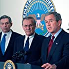 George W. Bush, Donald Rumsfeld, and Paul Wolfowitz in The Untold History of the United States (2012)
