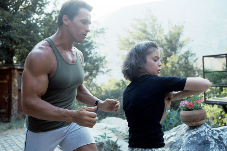 Alyssa Milano and Arnold Schwarzenegger in Commando (1985)