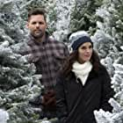 Erin Cahill and Justin Bruening in Last Vermont Christmas (2018)