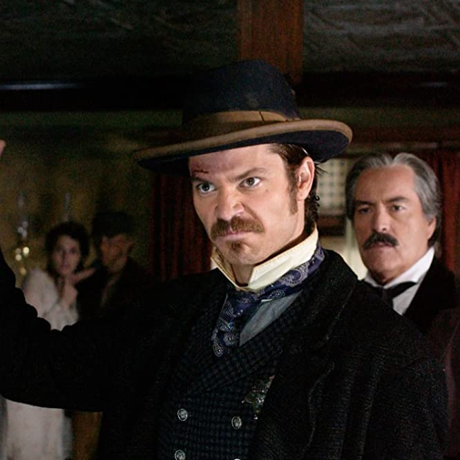 Powers Boothe and Timothy Olyphant in Deadwood (2004)
