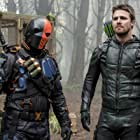 Manu Bennett and Stephen Amell in Arrow (2012)