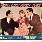 Joan Blondell, Robert Benchley, and John Howard in Three Girls About Town (1941)