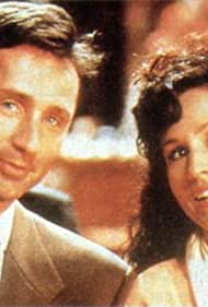 Erin Gray and Thierry Lhermitte in Les danseurs du Mozambique (1992)