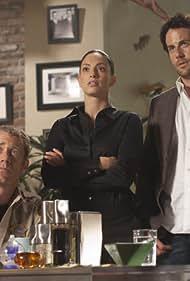 Colin Ferguson, Salli Richardson-Whitfield, Erica Cerra, and Niall Matter in Eureka (2006)