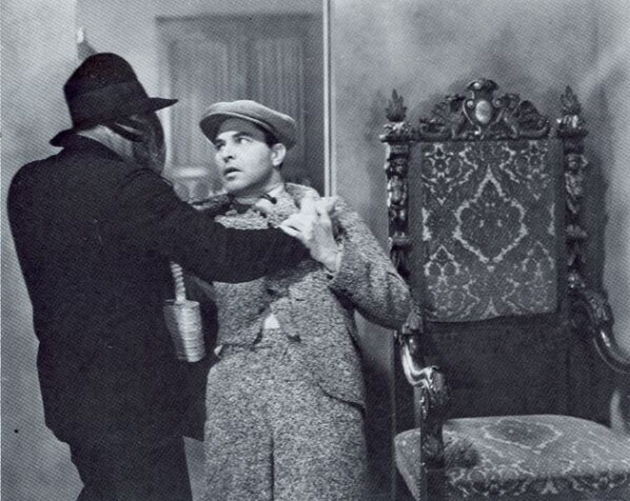 Malcolm McGregor in The Whispering Shadow (1933)