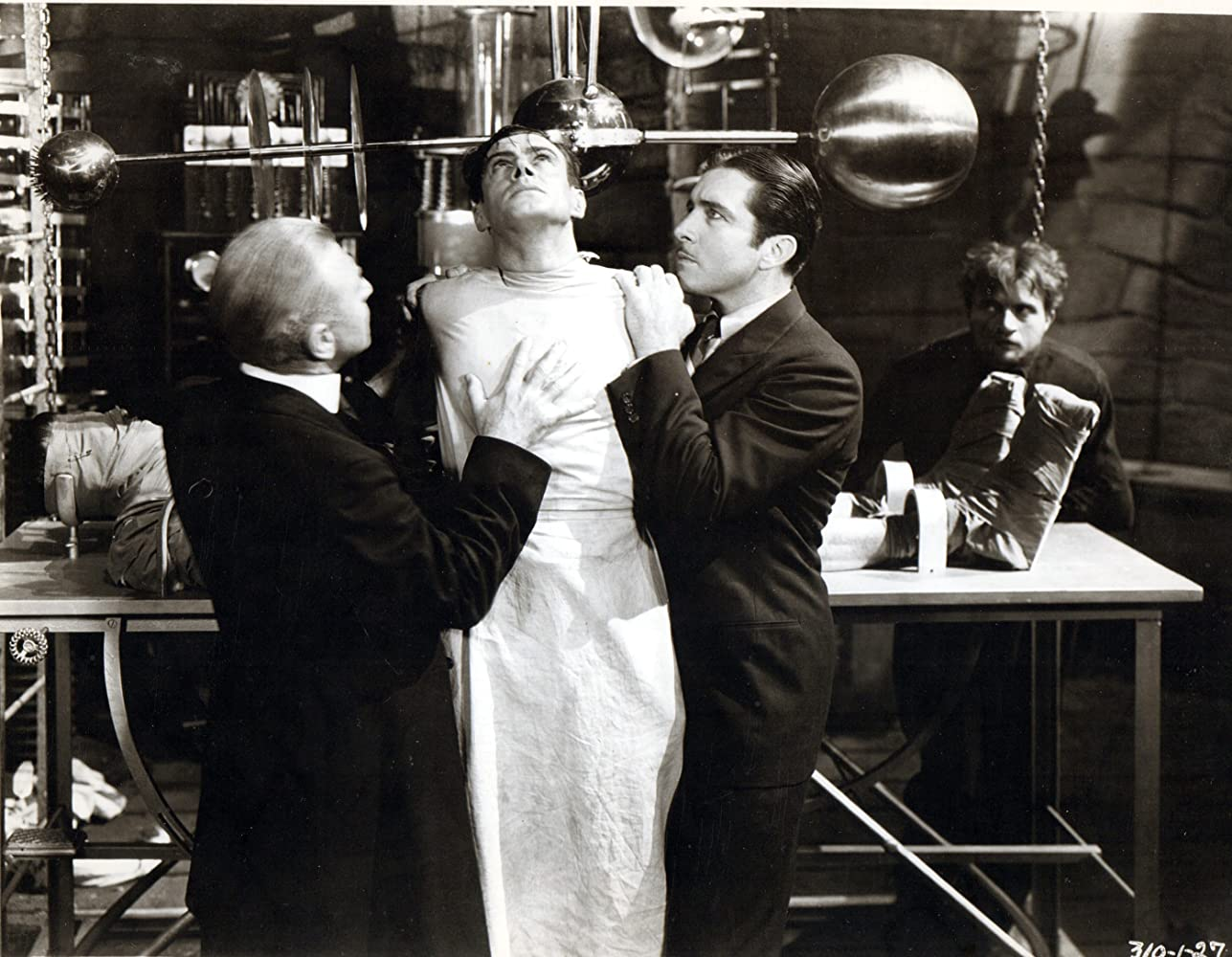 John Boles, Colin Clive, Dwight Frye, and Edward Van Sloan in Frankenstein (1931)