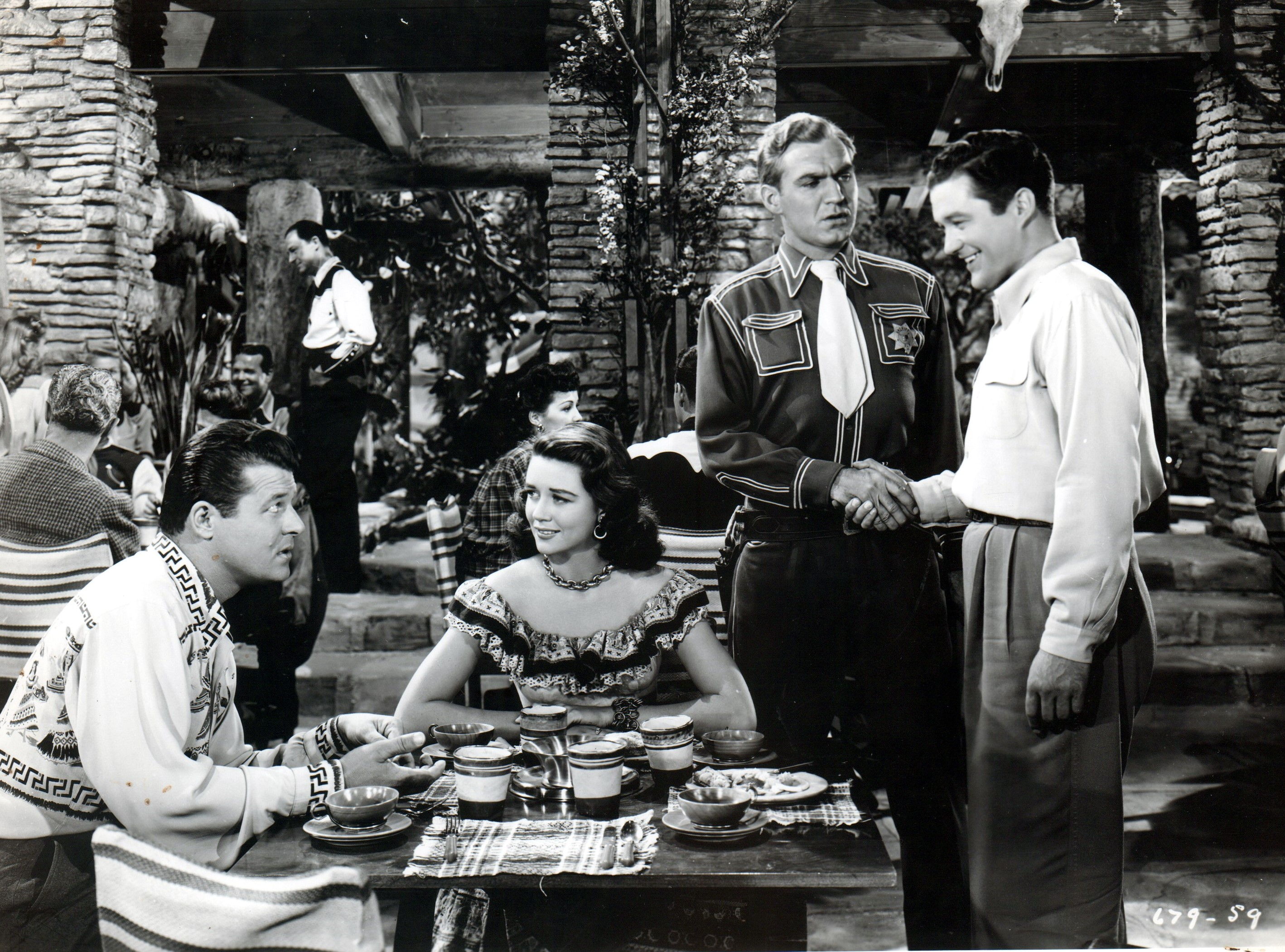 Jack Carson, Dorothy Malone, Dennis Morgan, and Forrest Tucker in Two Guys from Texas (1948)