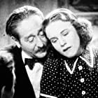 Deanna Durbin and Adolphe Menjou in One Hundred Men and a Girl (1937)