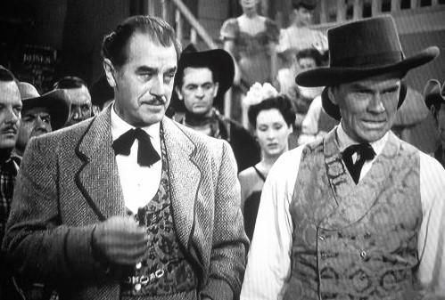 Ray Bennett, Pierce Lyden, and Harry Woods in Flame of the West (1945)