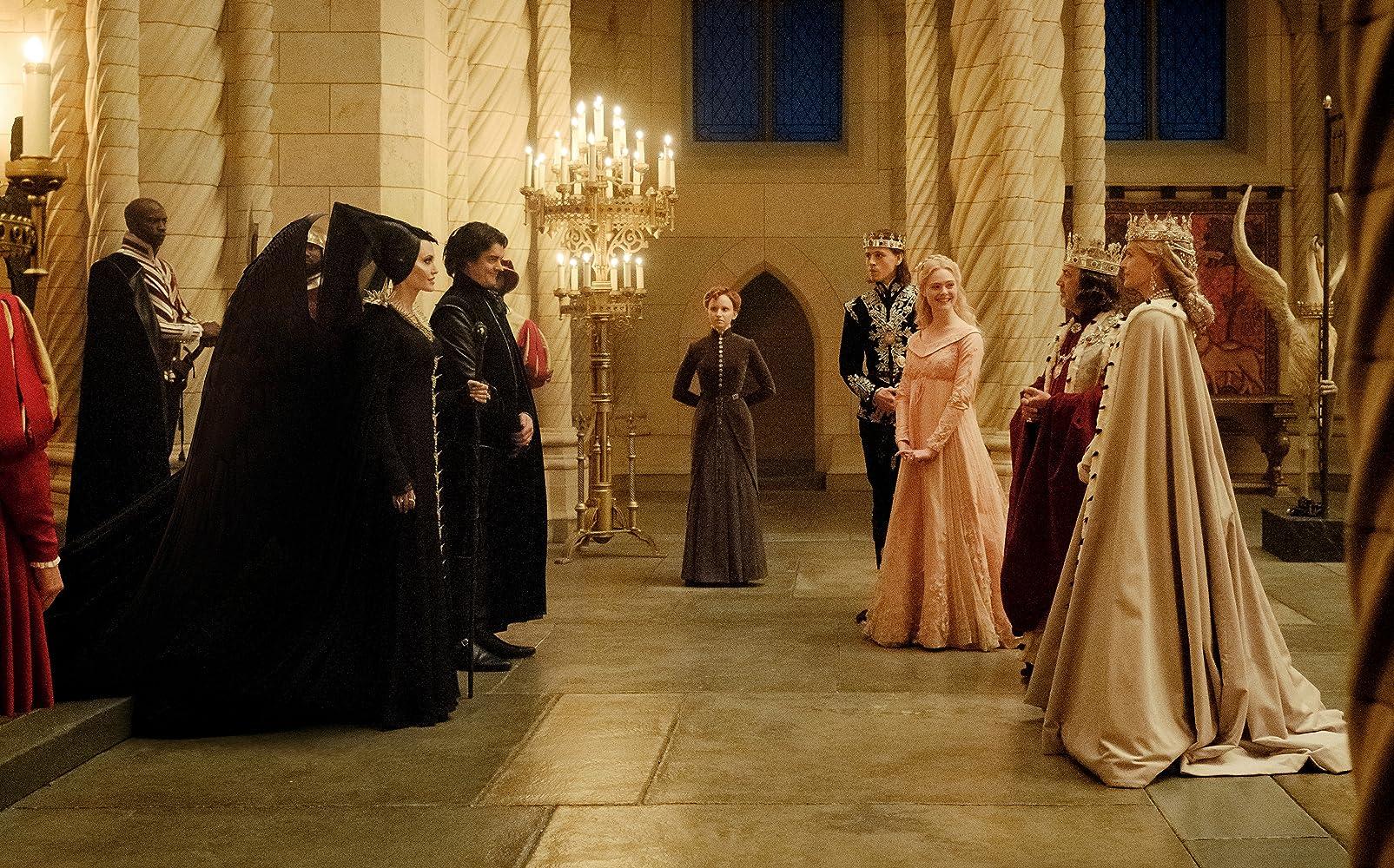 Michelle Pfeiffer, Angelina Jolie, Robert Lindsay, Sam Riley, Elle Fanning, David Gyasi, Jenn Murray, and Harris Dickinson in Maleficent: Mistress of Evil (2019)