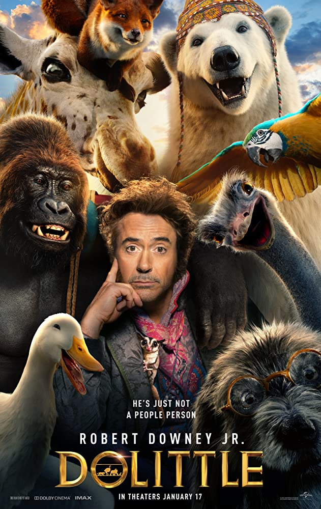 A picture of actor Robert Downey Jr. surrounded by a polar bear, gorilla, peacock, dog, fox, giraffe, swan, and a parrot.