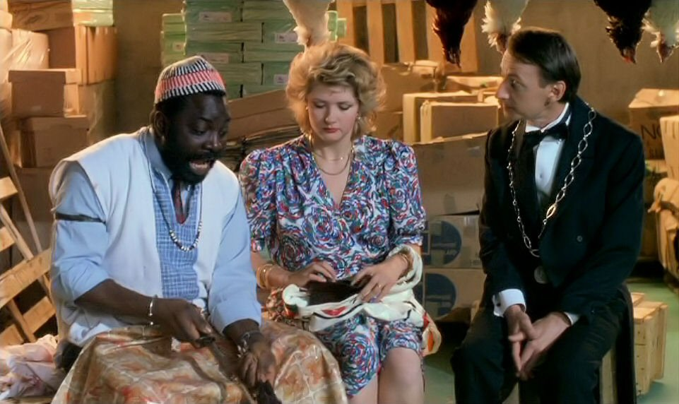 Cheik Doukouré, Catherine Jacob, and Patrice Minet in Les maris, les femmes, les amants (1989)
