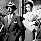 Jerome Cowan, Stuart Crawford, and Jane Wyman in Crime by Night (1944)