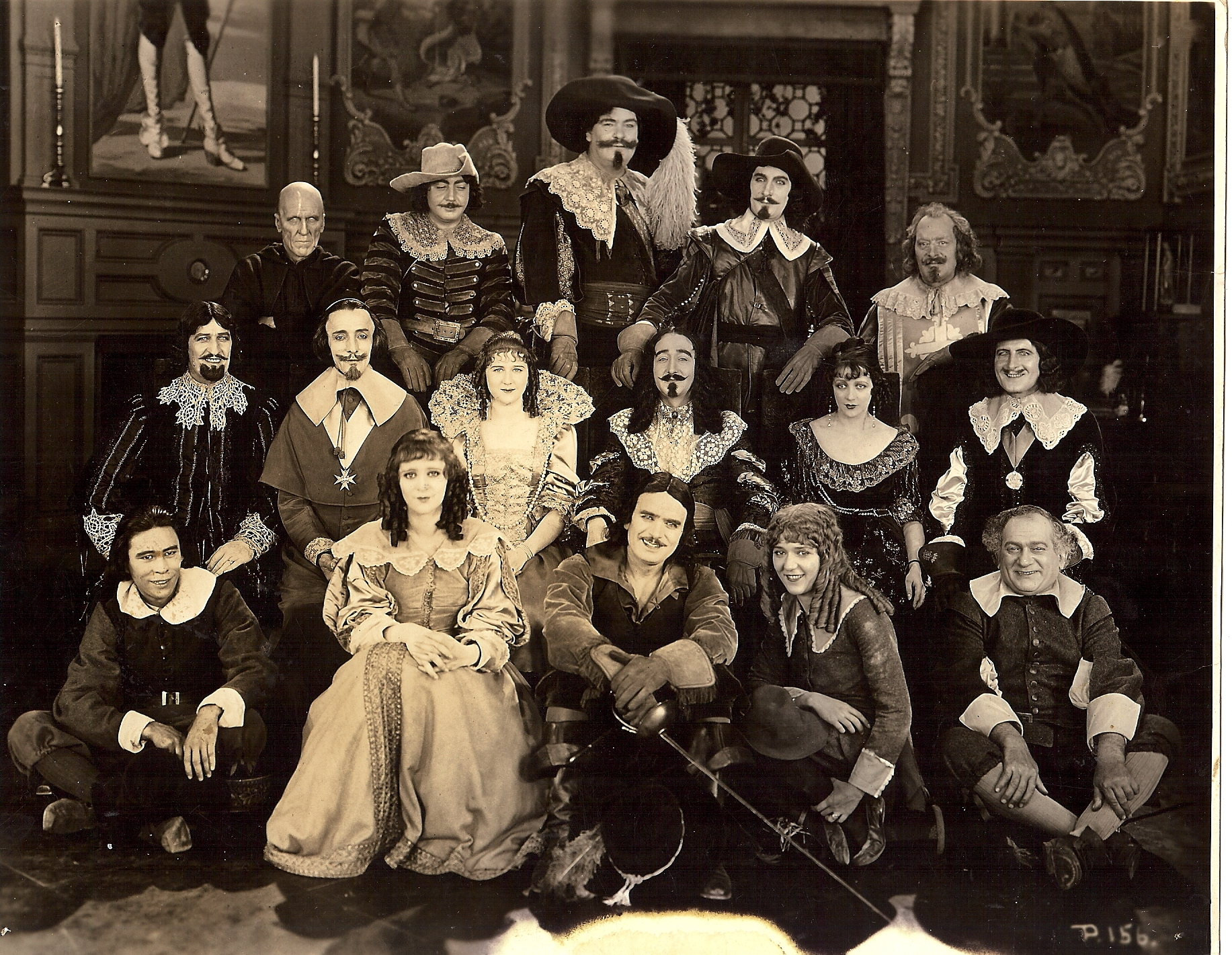 Douglas Fairbanks, Léon Bary, Nigel De Brulier, Marguerite De La Motte, Sidney Franklin, Thomas Holding, Boyd Irwin, Barbara La Marr, Mary MacLaren, Adolphe Menjou, Eugene Pallette, Lon Poff, Willis Robards, George Siegmann, and Charles Stevens in The Three Musketeers (1921)