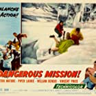 Piper Laurie, Victor Mature, and Betta St. John in Dangerous Mission (1954)