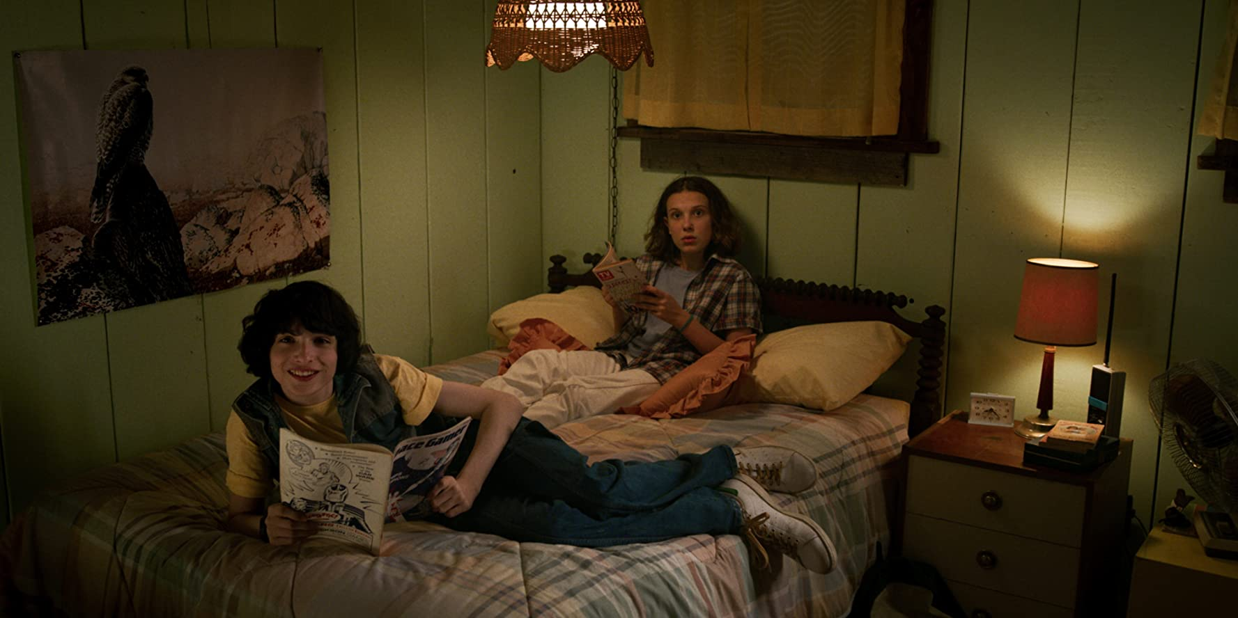 Millie Bobby Brown and Finn Wolfhard in Stranger Things (2016)