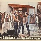 Kenne Duncan, Jack Randall, Glenn Strange, and Rusty the Horse in Covered Wagon Trails (1940)
