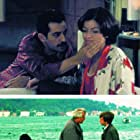 Tarik Akan, Okan Bayülgen, and Idil Firat in Gülüm (2003)