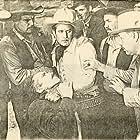 Richard Alexander, Chris Allen, Silver Tip Baker, Bob Custer, Jack Evans, J. Frank Glendon, Bud McClure, and Slim Whitaker in Law of the Wild (1934)
