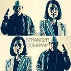 Danny Trejo and Jules Willcox in In Stranger Company (2020)