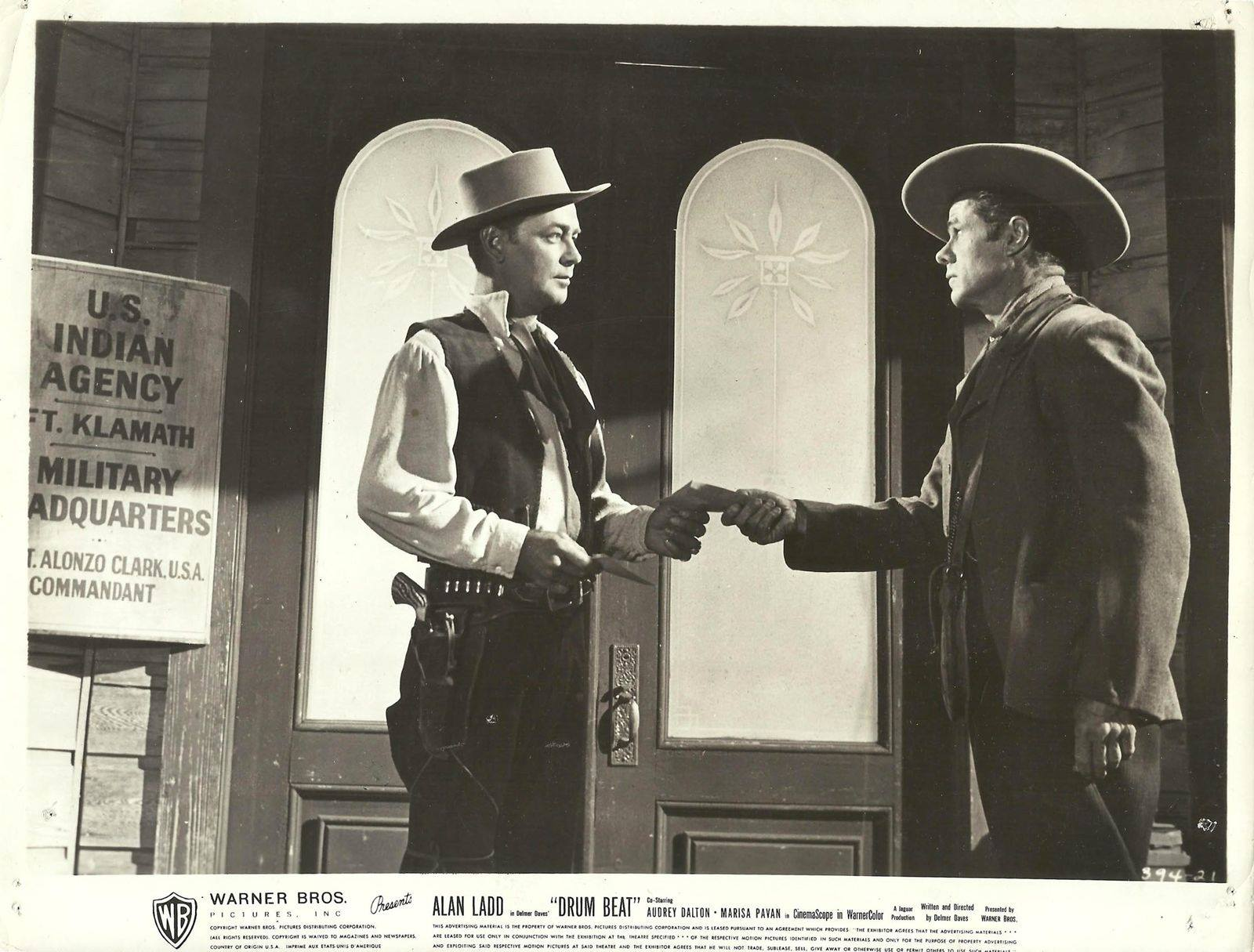 Alan Ladd and Elisha Cook Jr. in Drum Beat (1954)