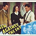 Wendy Barrie, Richard Dix, and Kent Taylor in Men Against the Sky (1940)