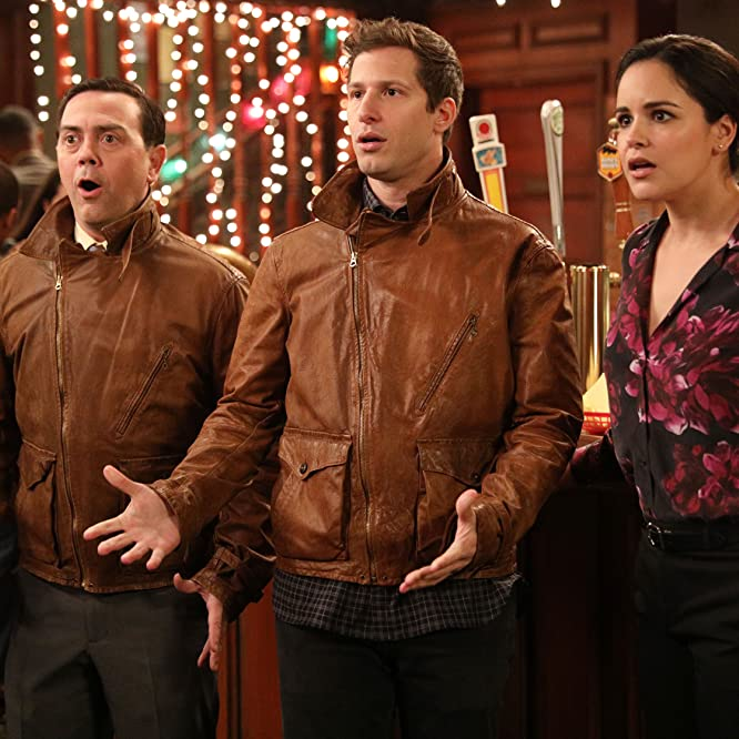 Melissa Fumero, Joe Lo Truglio, and Andy Samberg in Brooklyn Nine-Nine (2013)
