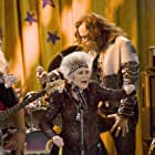 "Eve Brenner (with Steve Valentine, background) as Grandma Nana on ""I'm in the Band"""