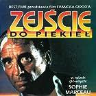 Sophie Marceau and Claude Brasseur in Descente aux enfers (1986)