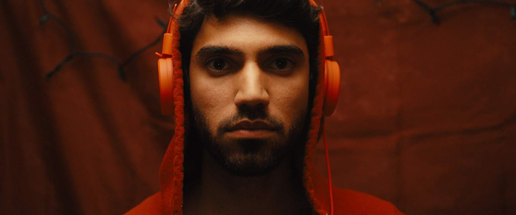 "Omar Maskati as ""Derek 'Milkshake' Qamar"" in Revenge Tour (2018)"