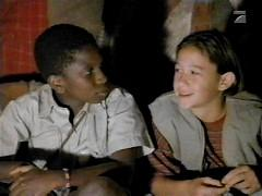 Joseph Gordon-Levitt and Adetokumboh M'Cormack in The Great Elephant Escape (1995)